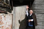 Victor Ivanov is greeting guests at the doorstep of his house in Isady village.